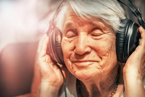 Woman listening through headphones