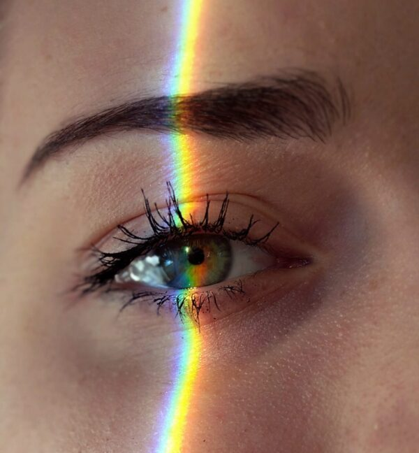 Woman's eye with rainbow
