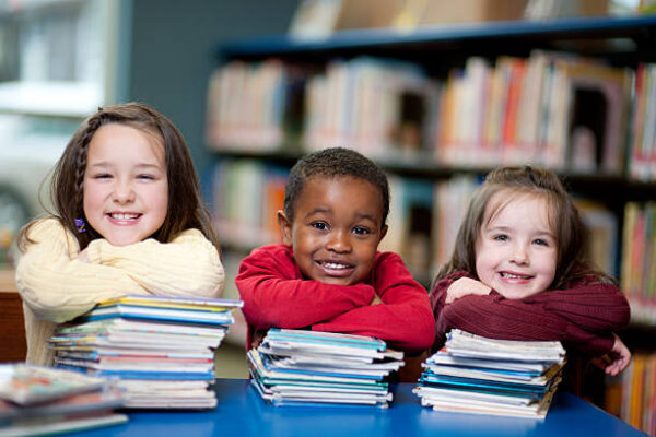 Kids in the library. Very shallow depth of field. Focus on boy in the middle.
