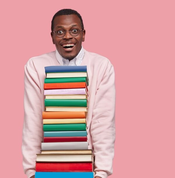 Happy man with lots of books in arms