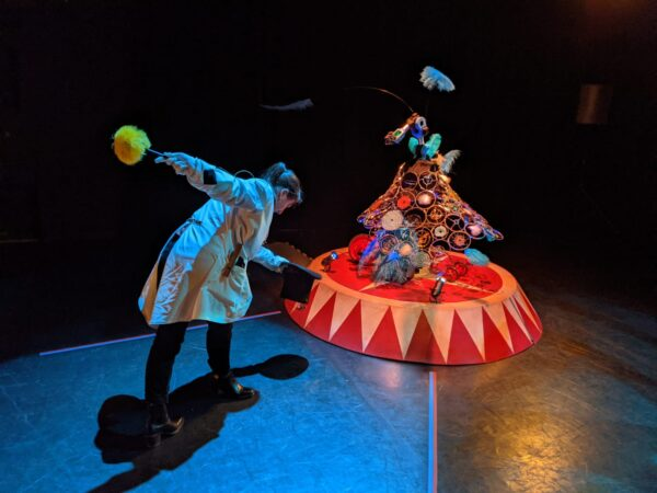 A picture of the dancer and an actor interacting with the contraption