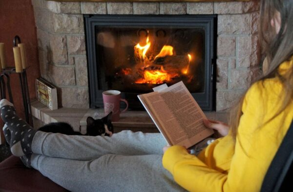 Reading a feel good read by the fire