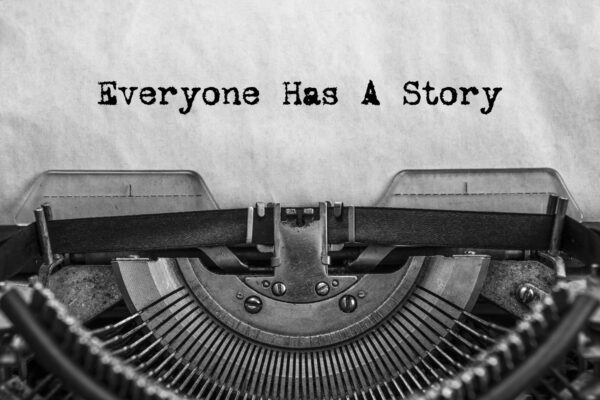old typewriter with text 'Everyone Has A Story'