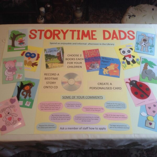 Photo of storytime dads information board that hangs in the prison