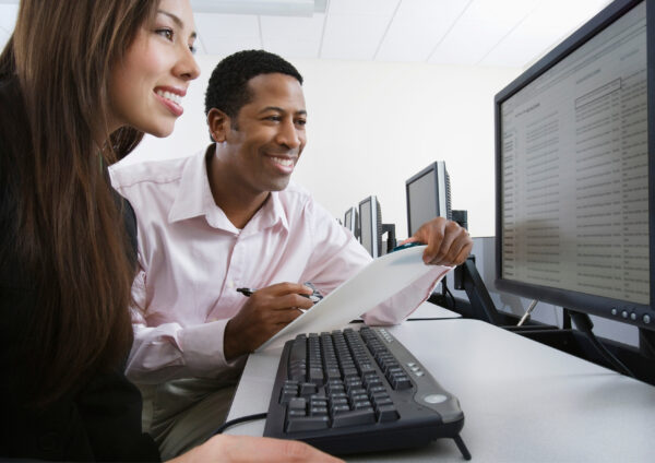 Two people sitting at a computer
